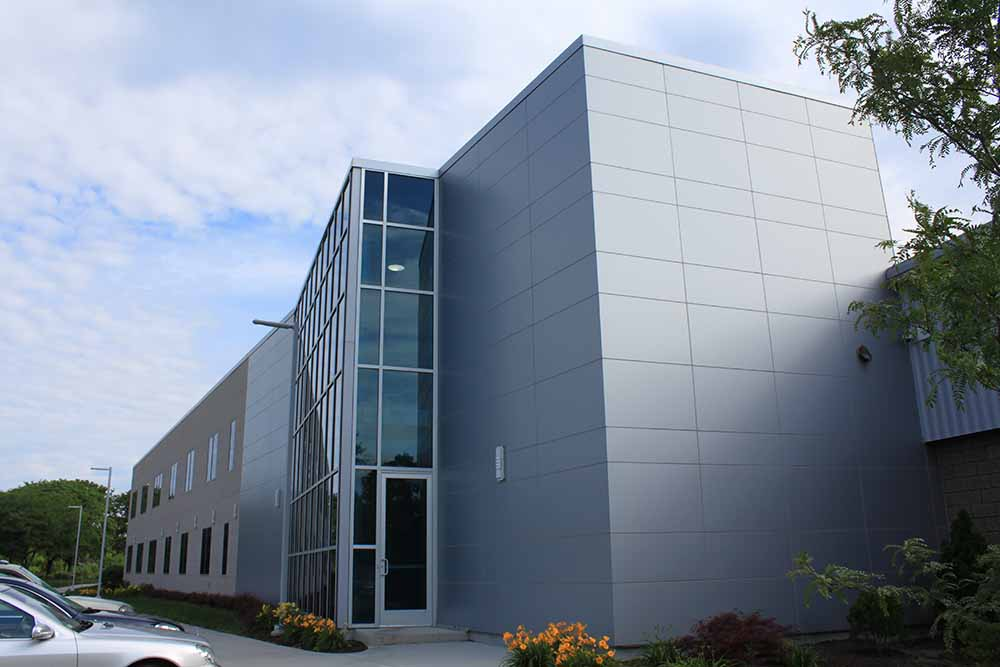 Creed Monarch - New Britain, CT - ALuminum composite panels, curtain wall, and composite stone panels